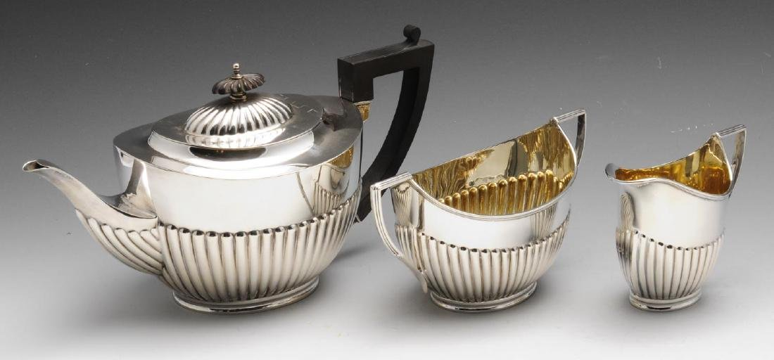 A matched early twentieth century three piece silver