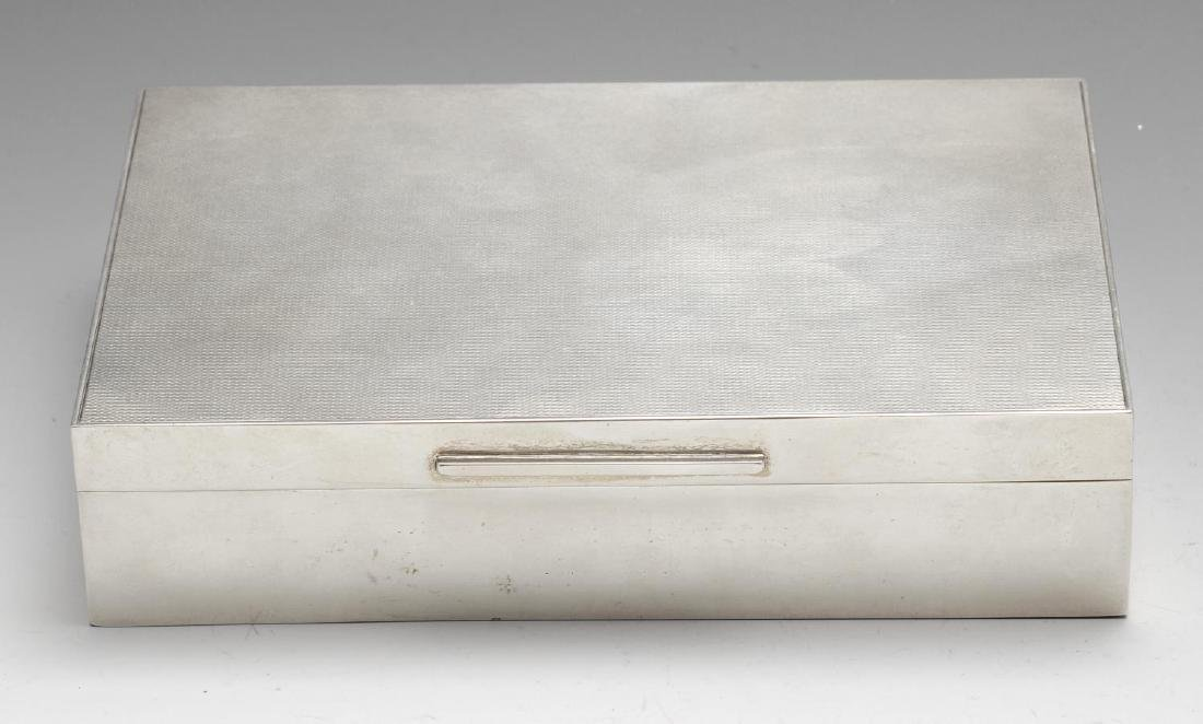 A silver mounted table cigarette box, of rectangular