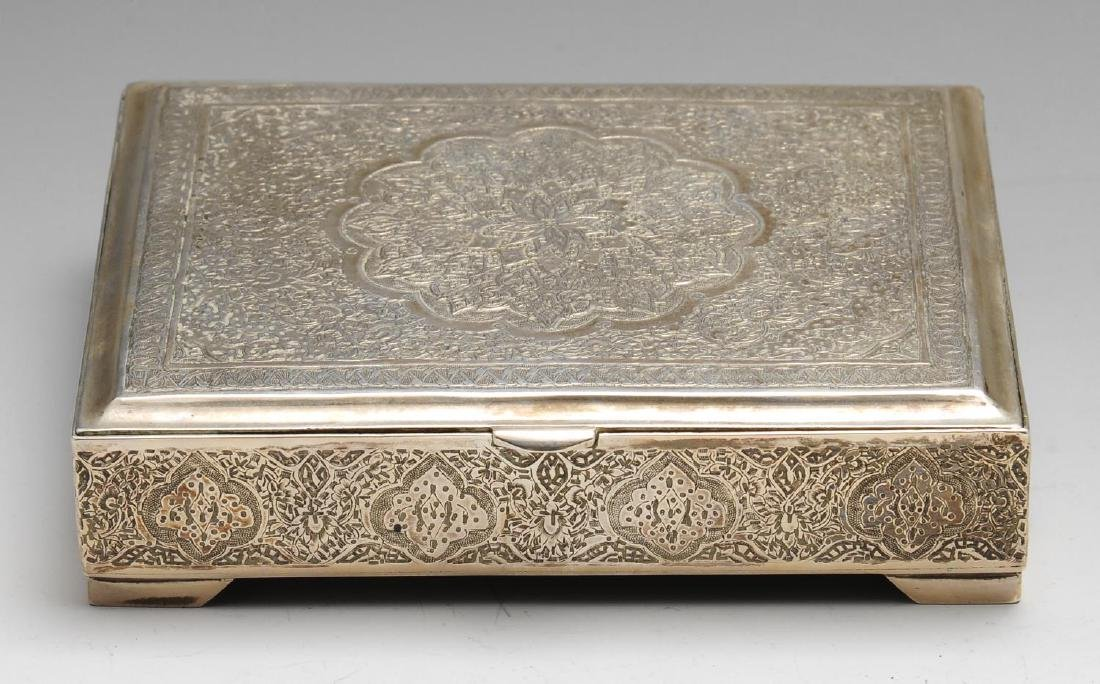 An Iranian silver cigarette box of oblong hinged form,