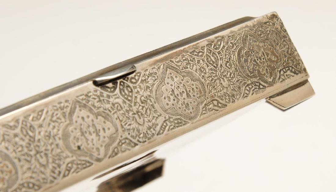 An Iranian silver cigarette box of oblong hinged form, - 6