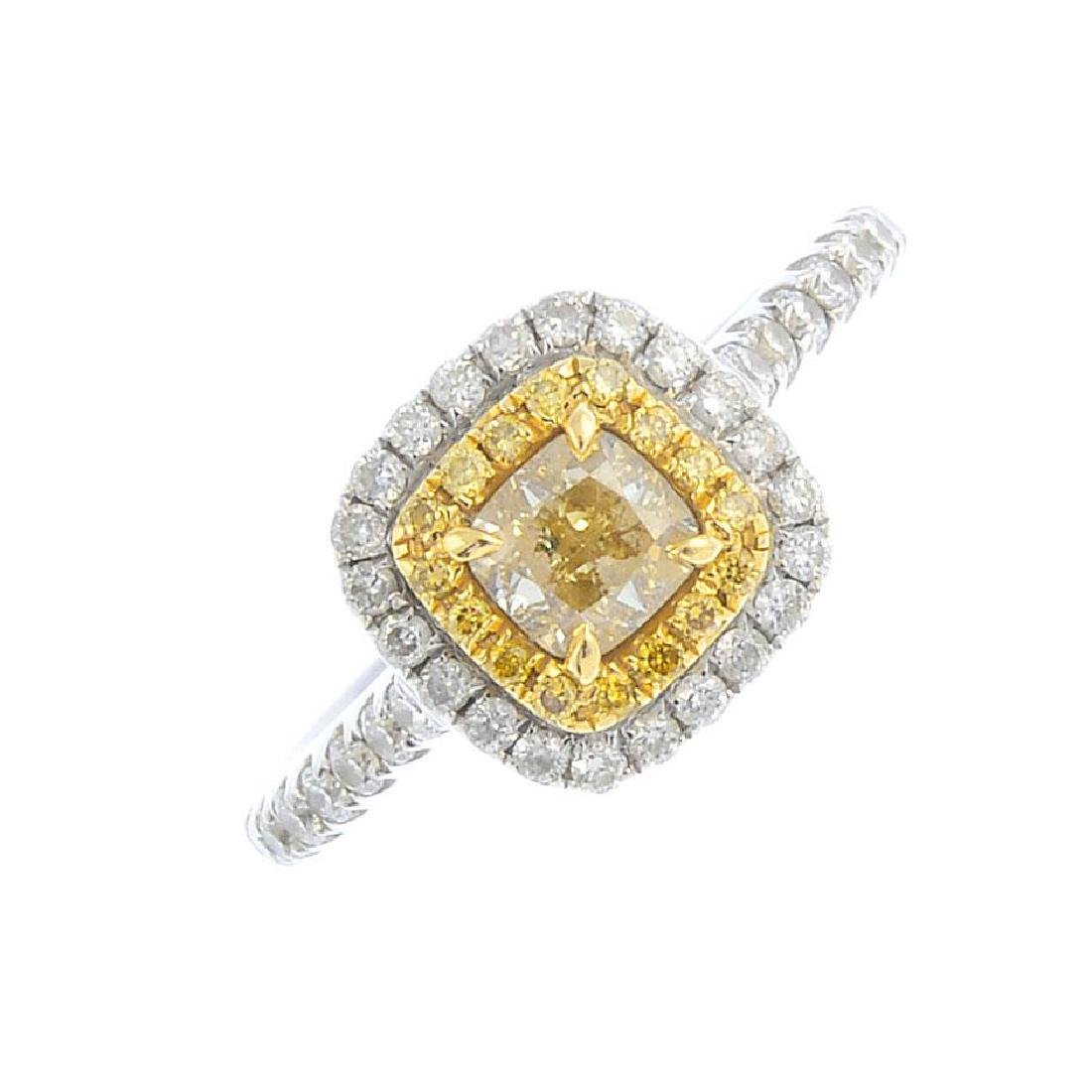 An 18ct gold 'coloured' diamond and diamond cluster