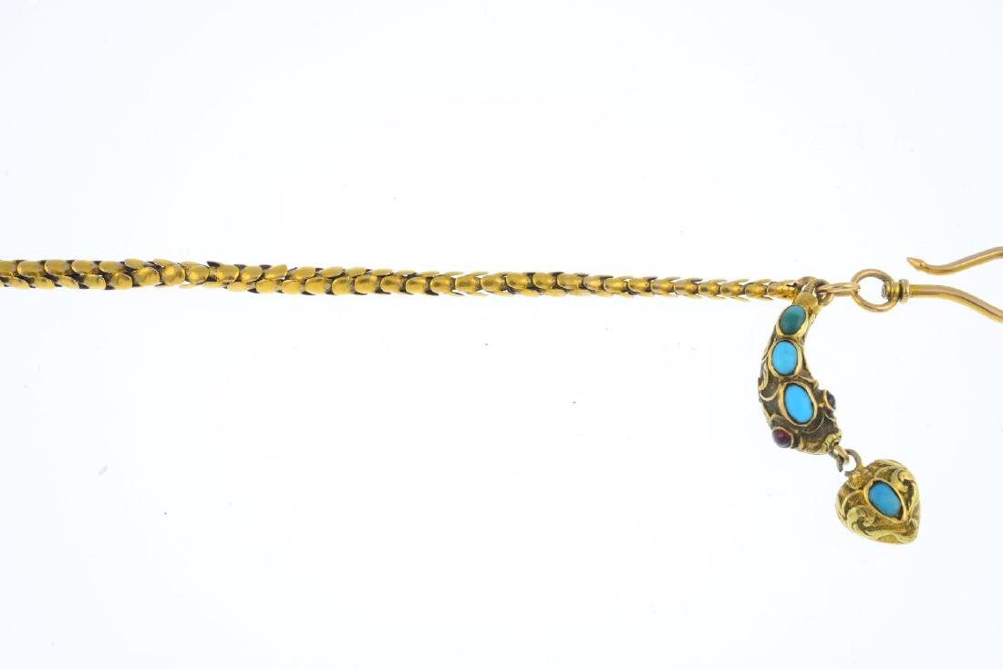A late Victorian gold gem-set snake bracelet. The oval - 2