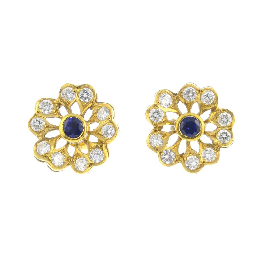 A pair of 18ct gold sapphire and diamond floral