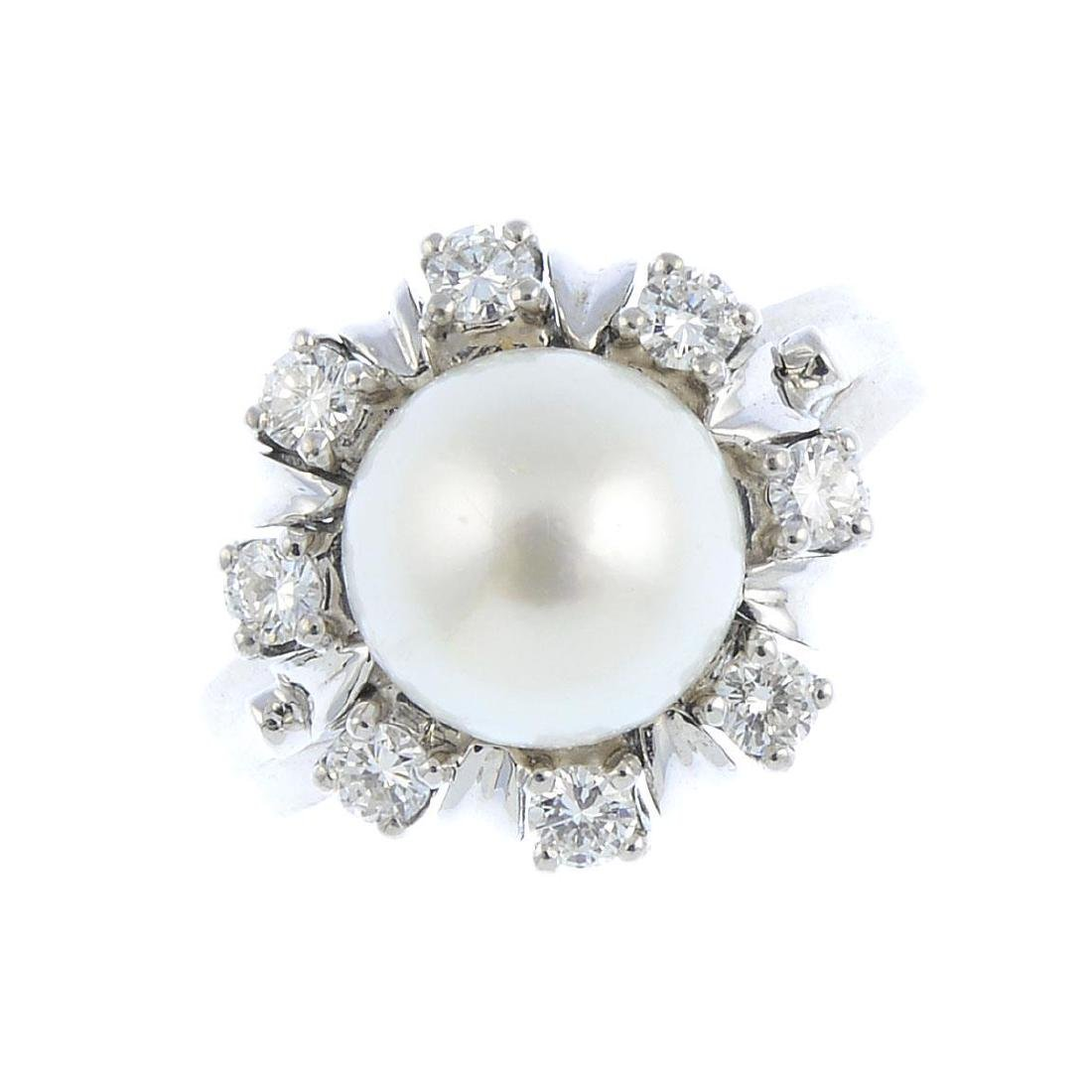 A cultured pearl and diamond floral cluster ring. The