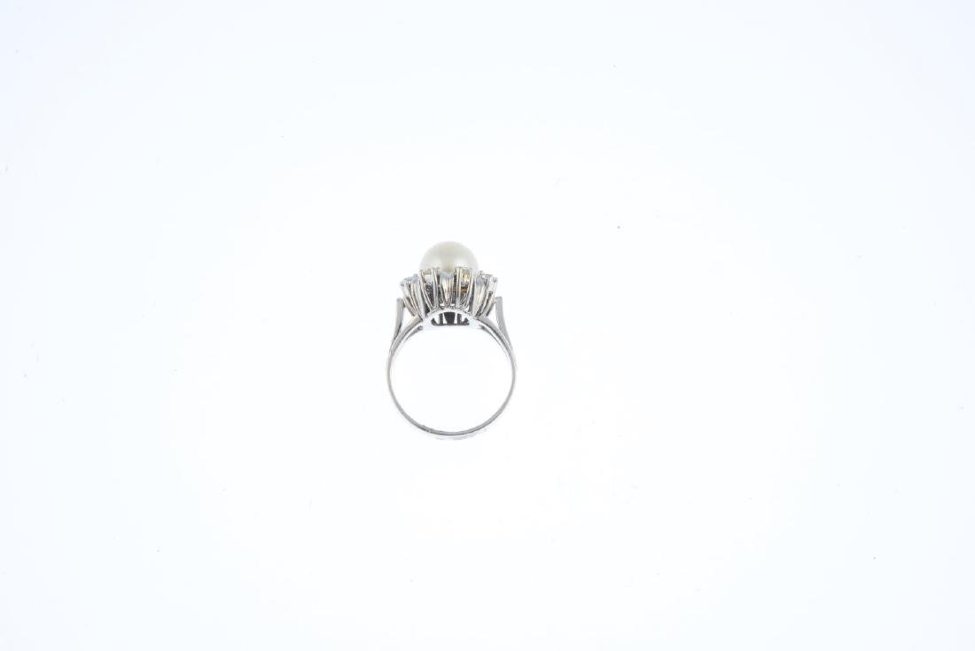A cultured pearl and diamond floral cluster ring. The - 2