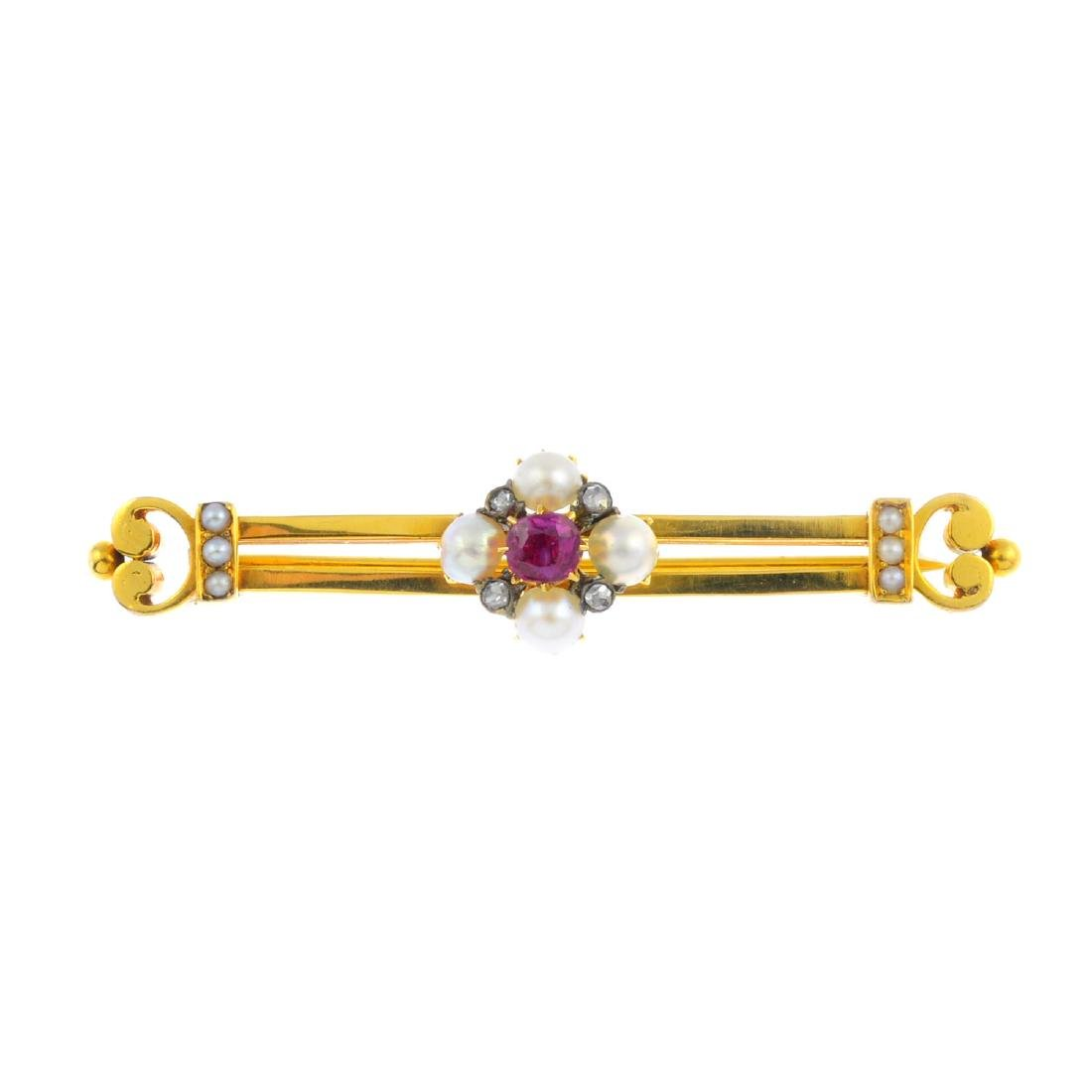 An early 20th century gold ruby, split pearl and