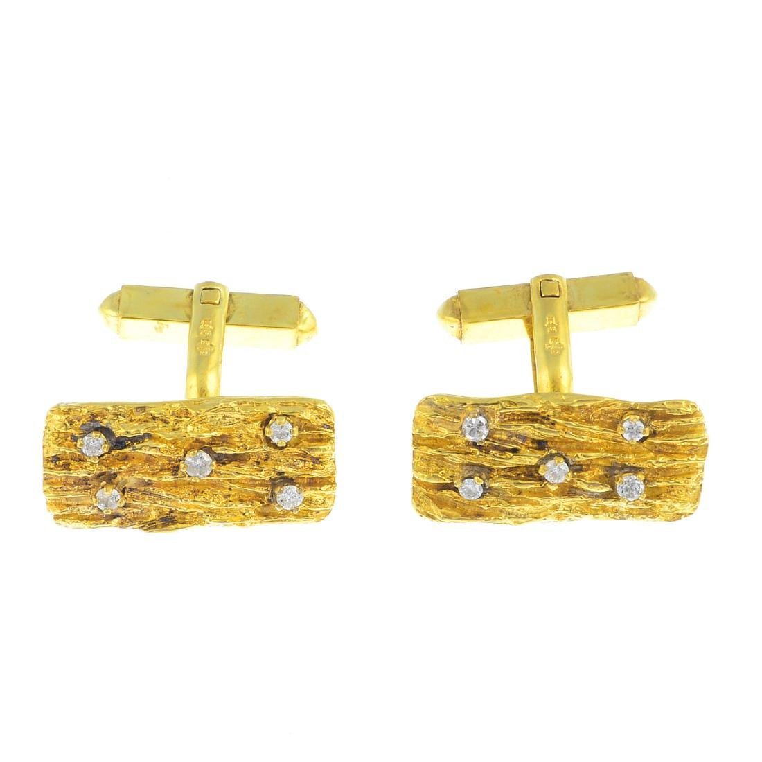 A pair of 18ct gold diamond cufflinks. Each designed as