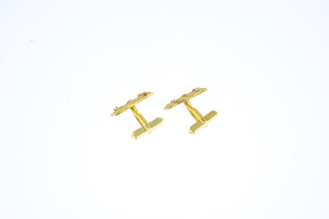 A pair of 18ct gold diamond cufflinks. Each designed as - 2