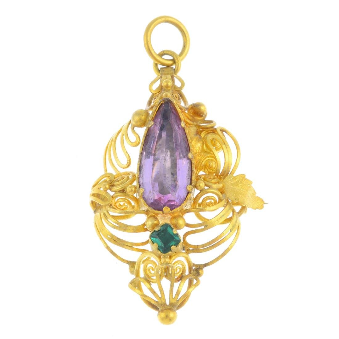 A topaz and emerald pendant. Of openwork design, the