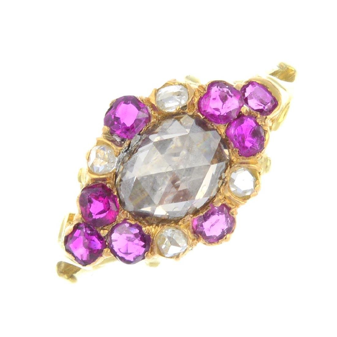 A diamond and ruby cluster ring. The rose-cut diamond,
