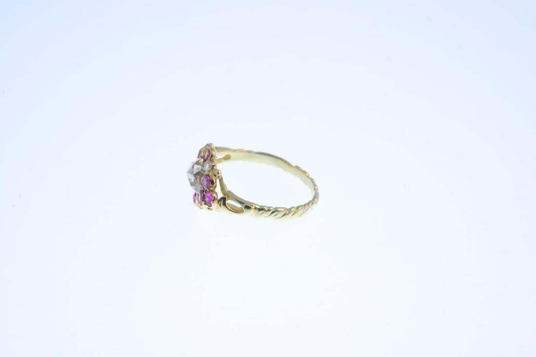 A diamond and ruby cluster ring. The rose-cut diamond, - 2