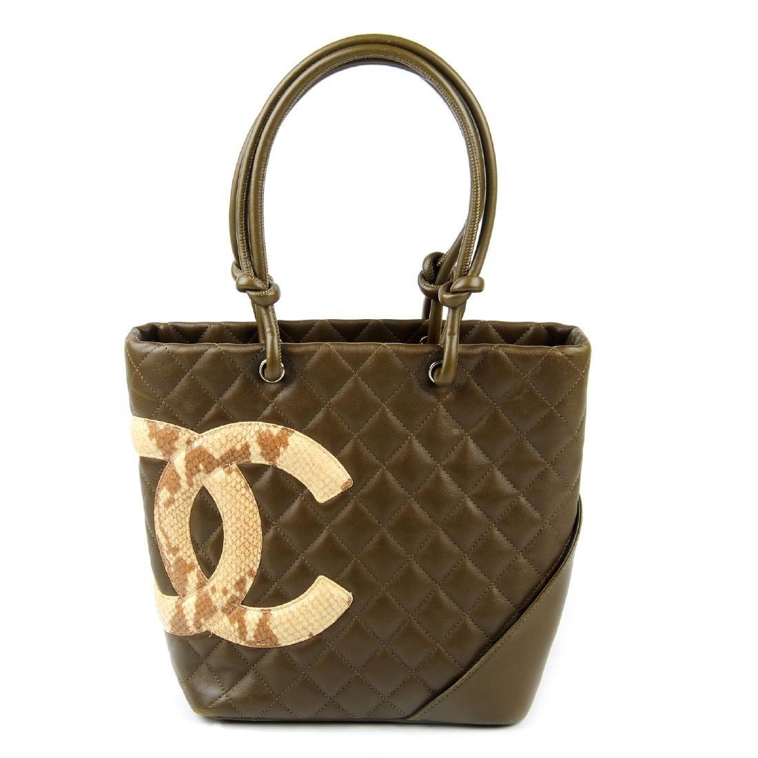 CHANEL - a Ligne Cambon handbag. Featuring a khaki