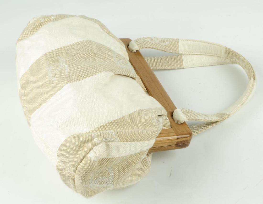CHANEL - a white and beige canvas handbag. Designed - 2
