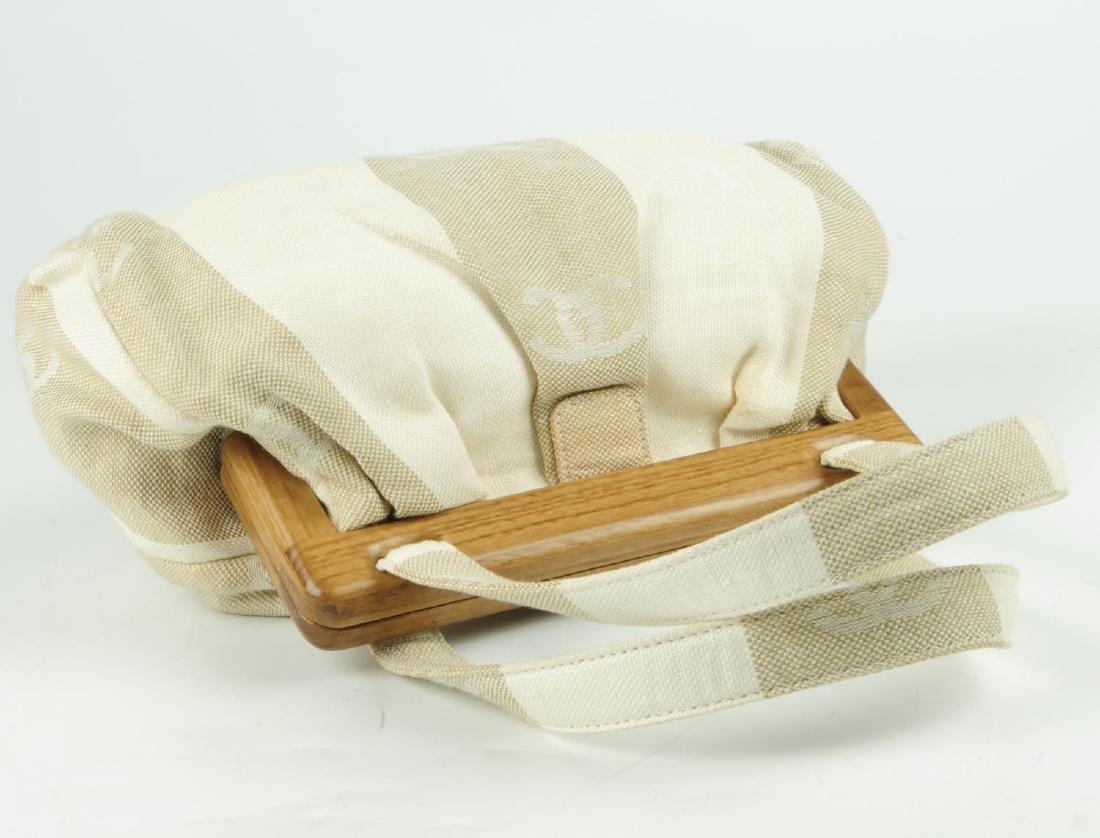 CHANEL - a white and beige canvas handbag. Designed - 5