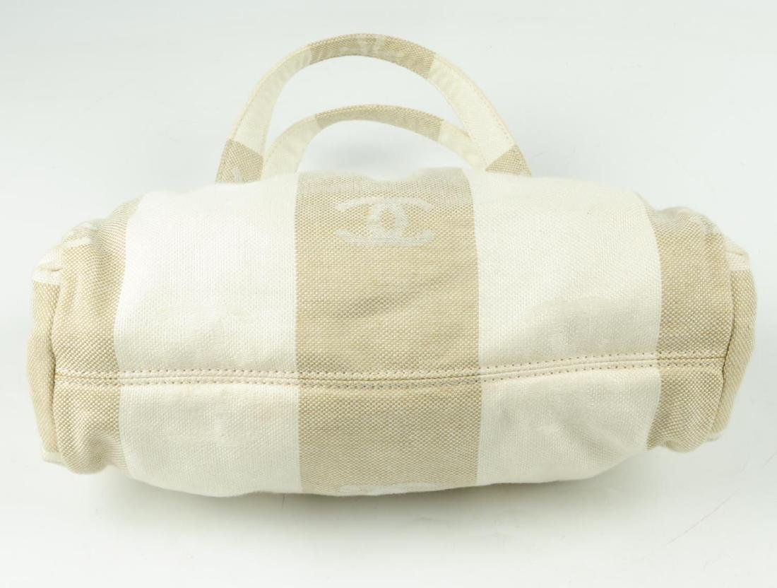 CHANEL - a white and beige canvas handbag. Designed - 7