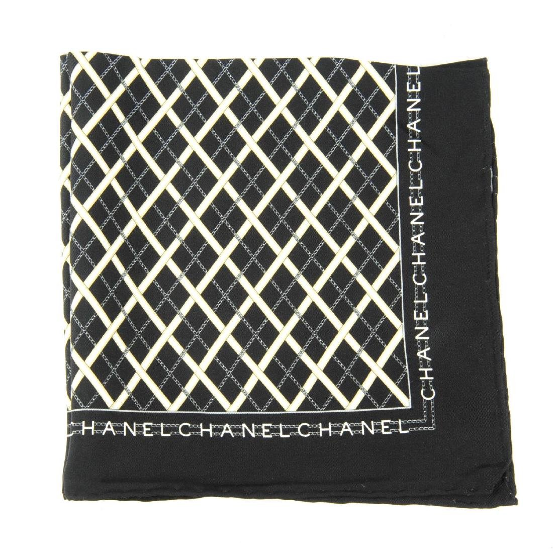 CHANEL - a small silk scarf. A black scarf with a white