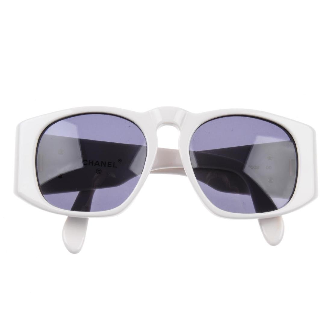 CHANEL - a pair of sunglasses. Designed with white