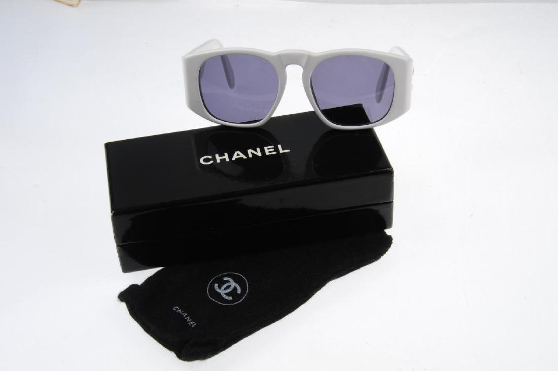 CHANEL - a pair of sunglasses. Designed with white - 4