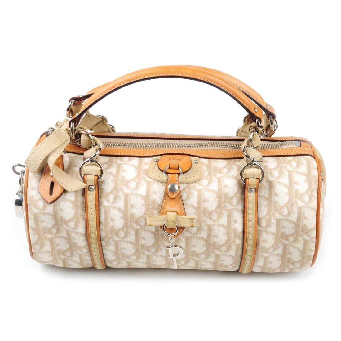 CHRISTIAN DIOR - a small Romantique barrel handbag.