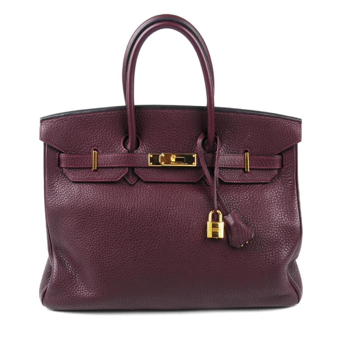 HERMÈS - a plum Clemence Birkin 35 handbag. Designed