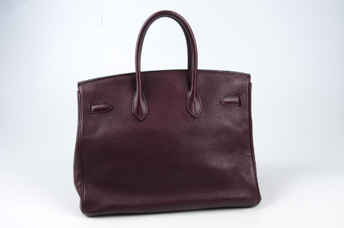 HERMÈS - a plum Clemence Birkin 35 handbag. Designed - 2