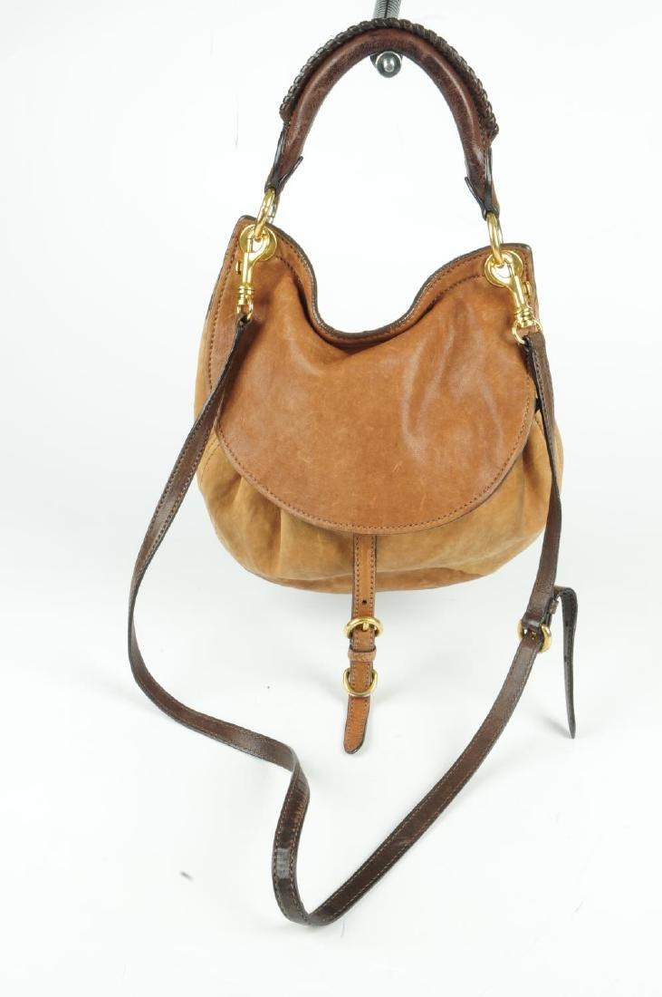 MIU MIU - a leather saddle handbag. Designed with a tan - 2