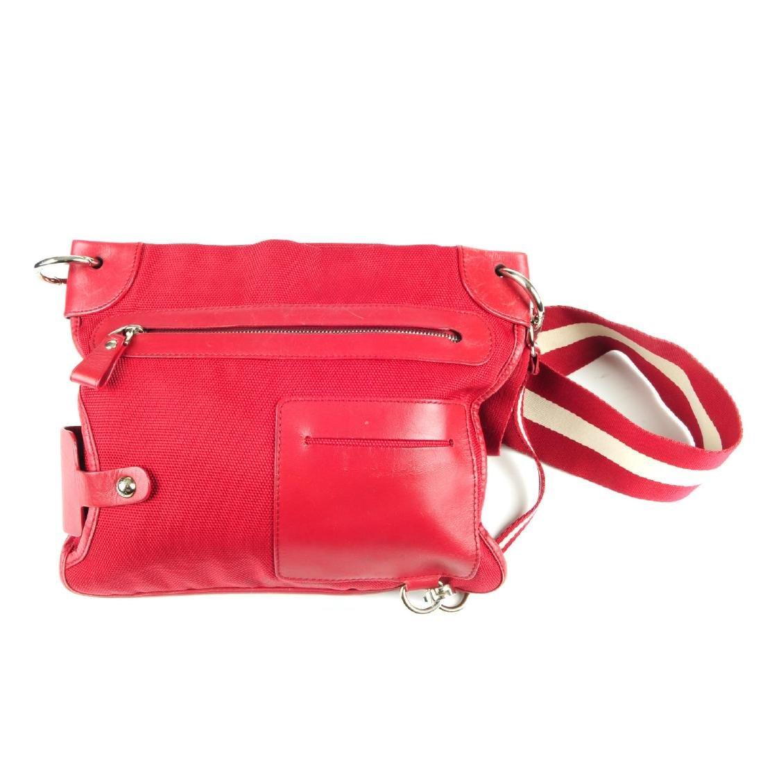 Two designer handbags. To include a red canvas Bally
