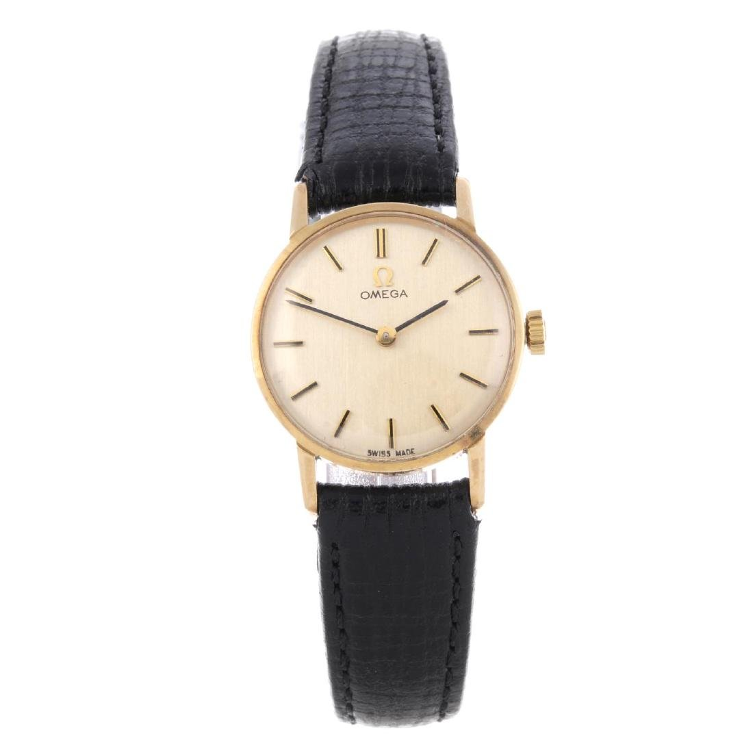 OMEGA - a lady's wrist watch. 9ct yellow gold case,