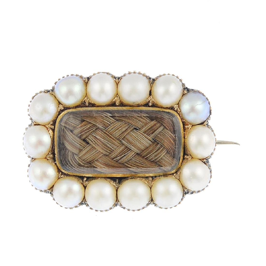 A George IV gold split pearl mourning brooch. Of