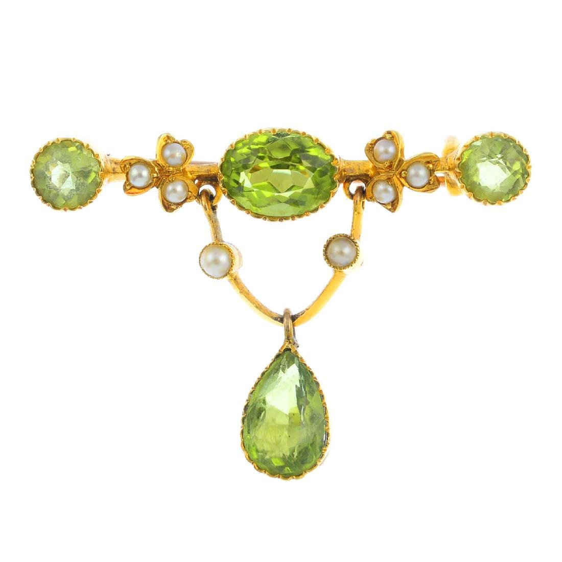 An early 20th century gold peridot and split pearl