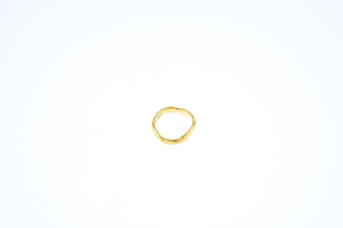 An 18ct gold ring. Designed as an undulating band. - 2