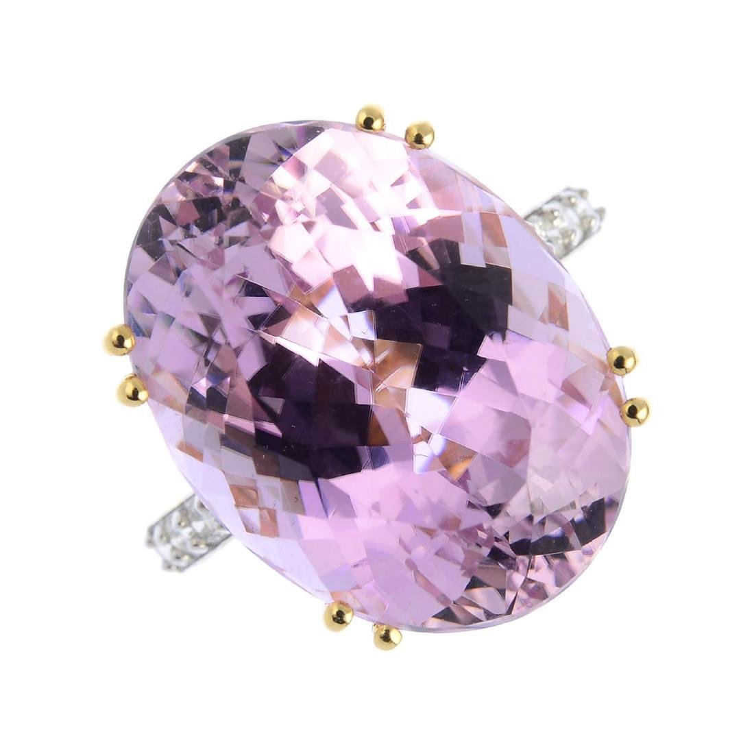 An 18ct gold kunzite and diamond ring. The oval-shape