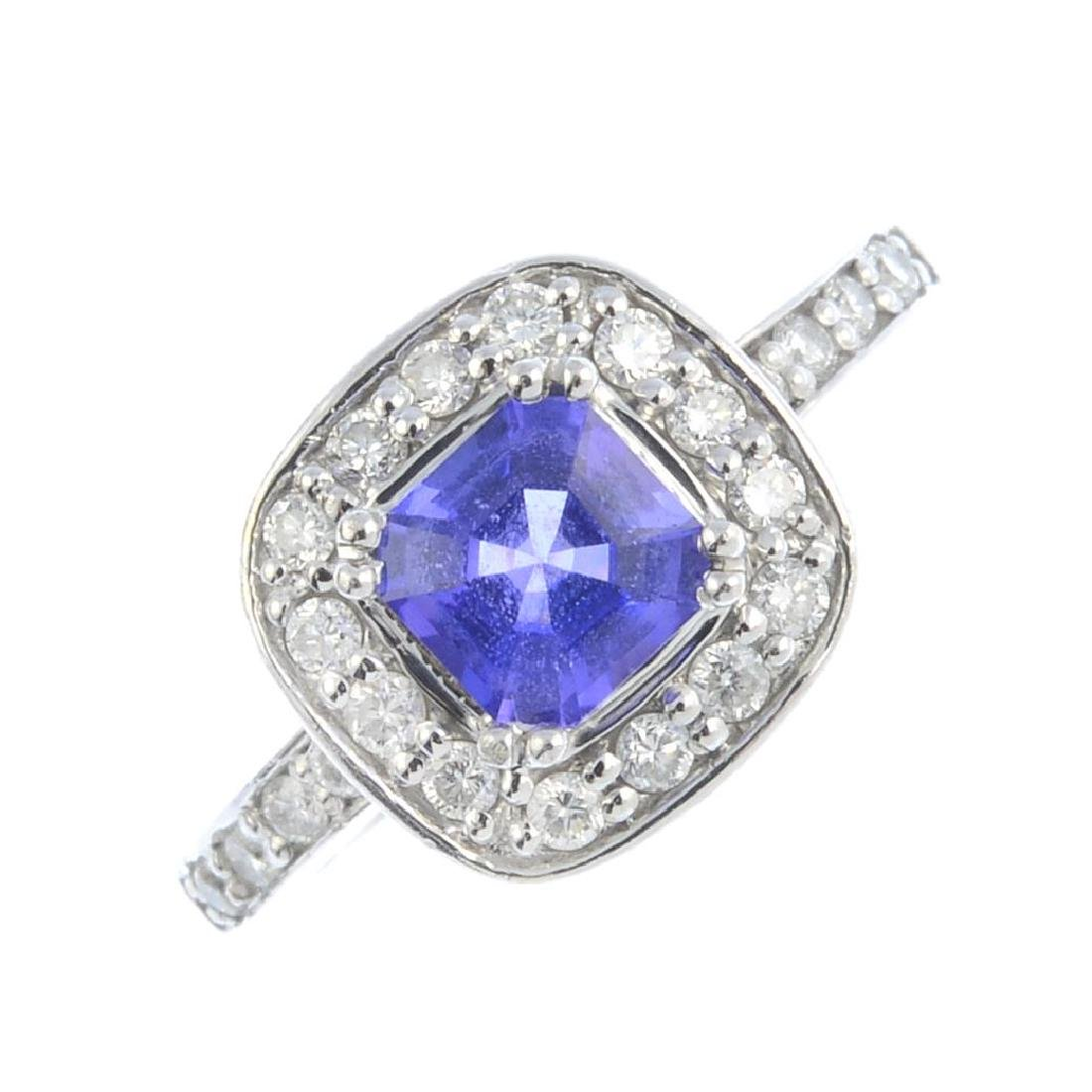 An 18ct gold tanzanite and diamond ring. Designed as a