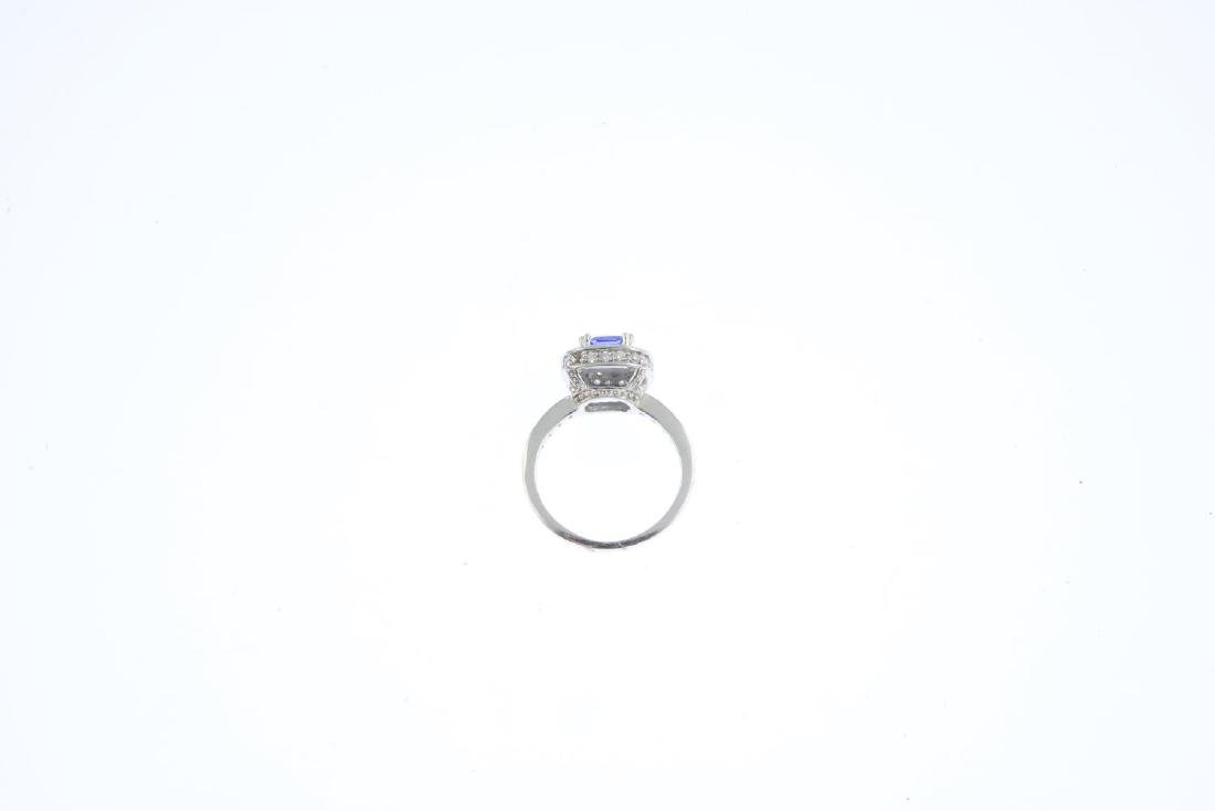 An 18ct gold tanzanite and diamond ring. Designed as a - 2