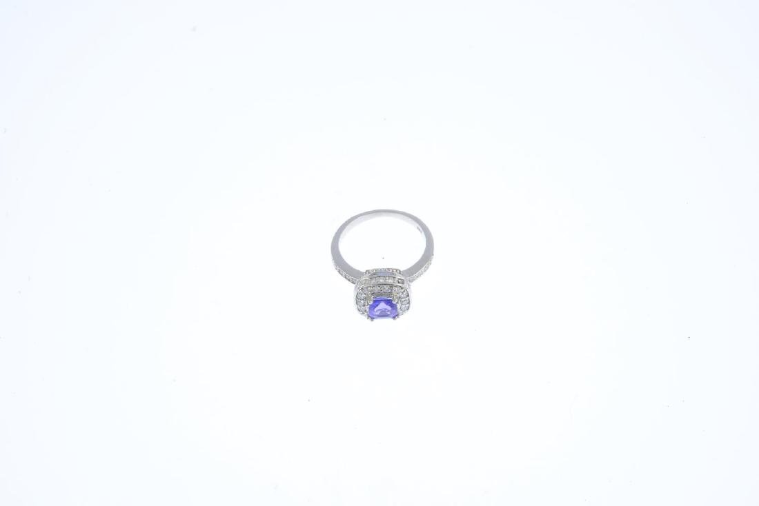 An 18ct gold tanzanite and diamond ring. Designed as a - 3