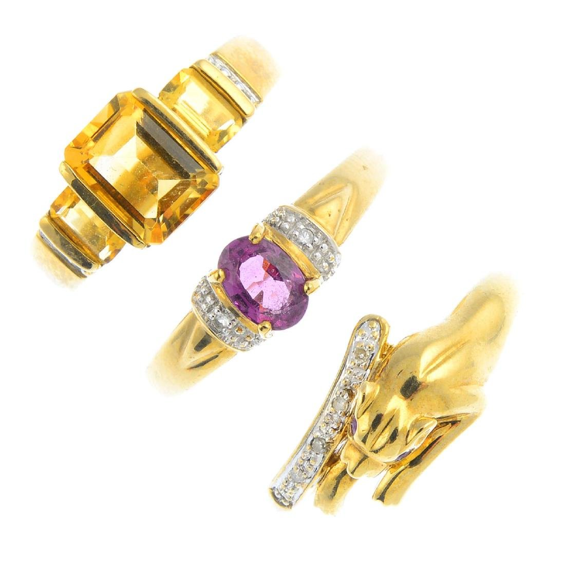 Four 9ct gold gem-set rings and a pair of earrings. To