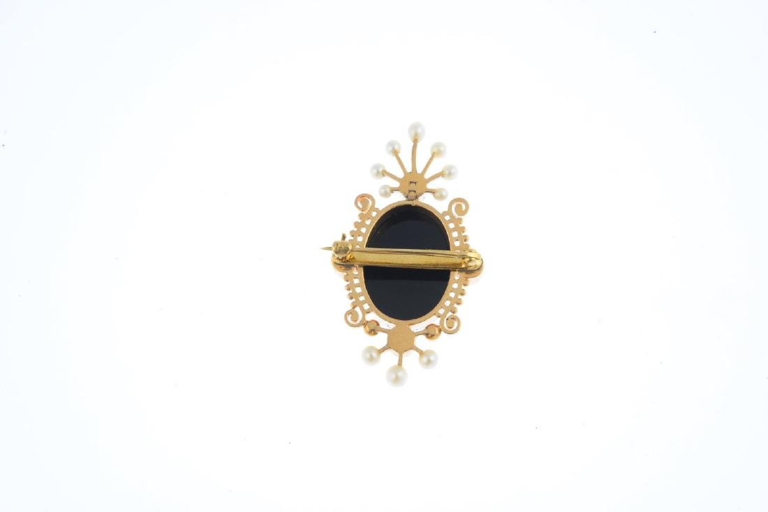 An onyx and split pearl brooch. The oval onyx cameo, - 2