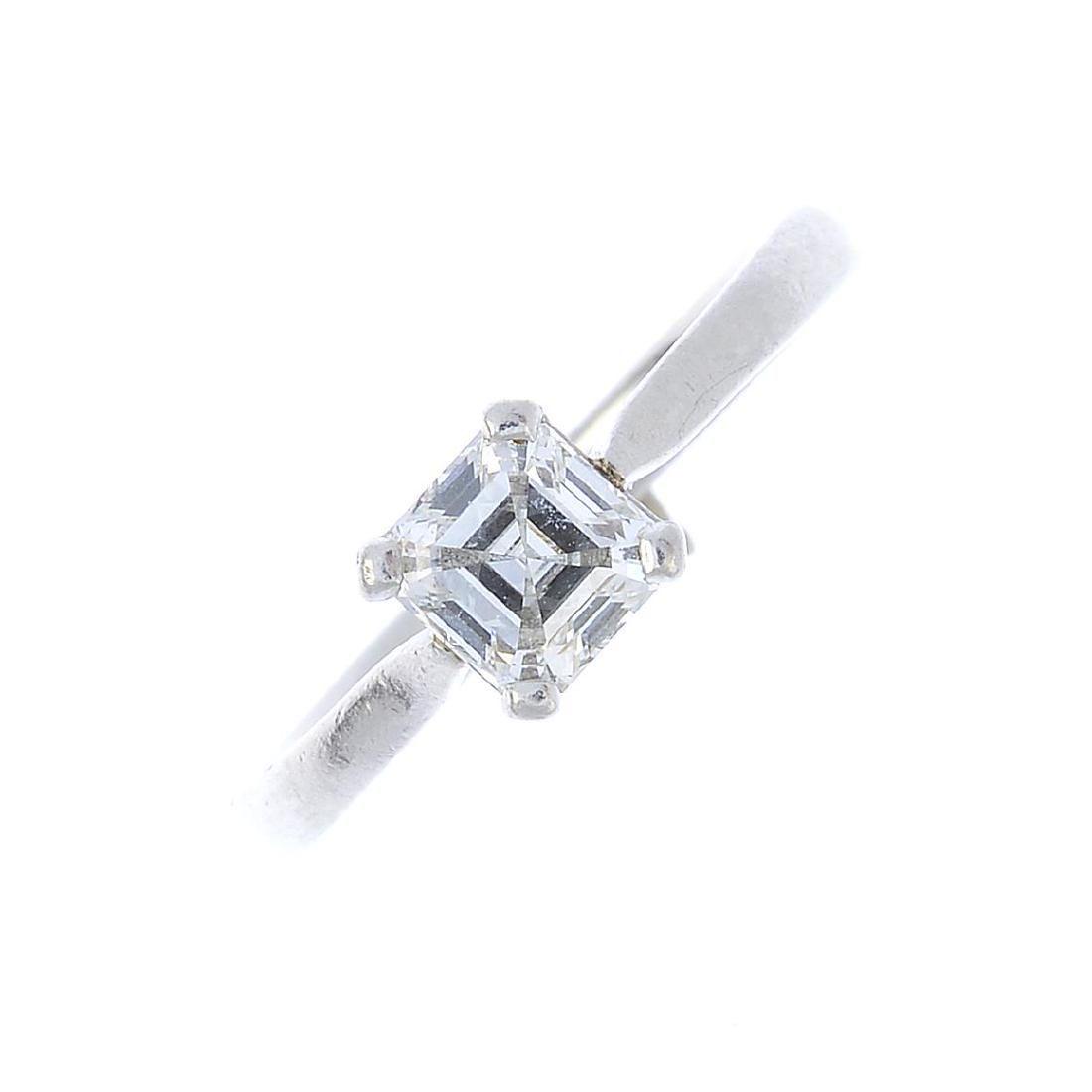 A platinum diamond single-stone ring. The square-shape