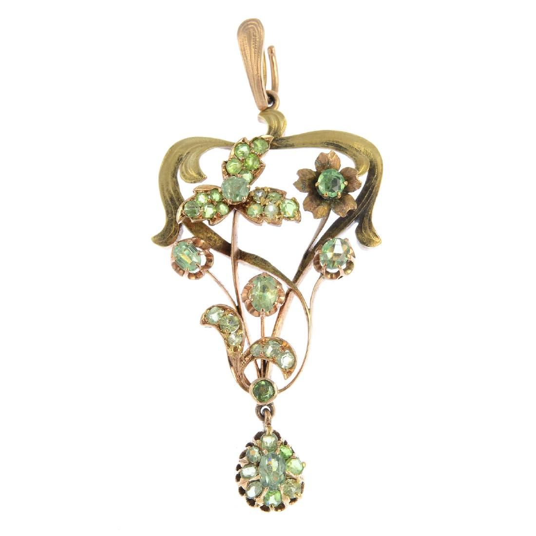 An early 20th century gold demantoid garnet pendant.