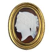 A late Victorian 18ct gold sardonyx cameo brooch. Of