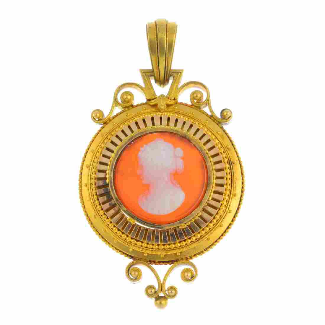 A mid Victorian gold agate cameo pendant. Of circular