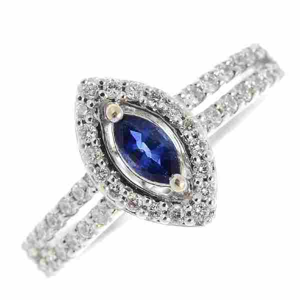 An 18ct gold diamond and sapphire cluster ring The