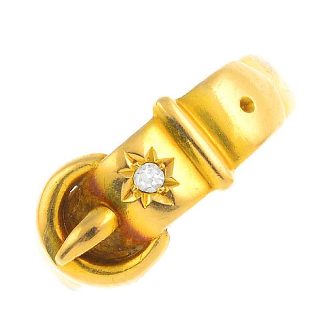 A late Victorian 18ct gold diamond buckle ring.