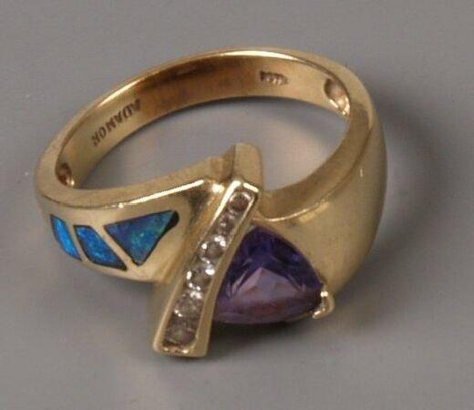 5: Gold  mounted dress ring with triangular tanzanite,
