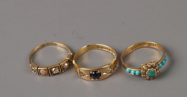 8: Three gold stone set rings to include a Victorian 15