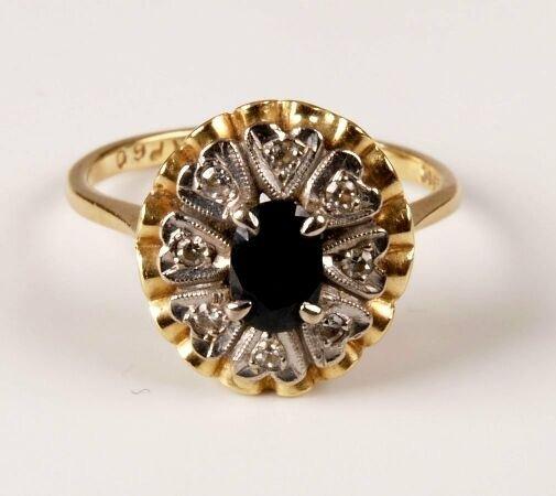 13: 18ct gold oval sapphire and single cut diamond clus
