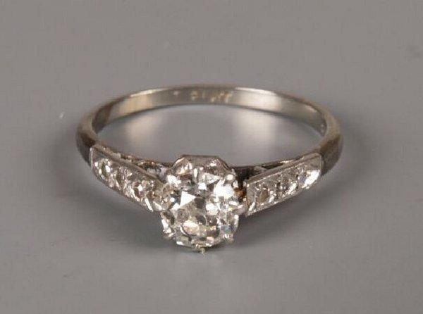 15: 18ct white gold and platinum mounted single stone o
