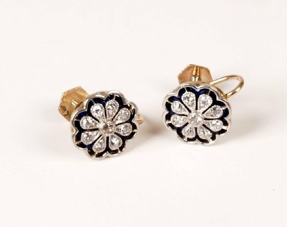 24: A pair of floral shaped screw back earrings set wit