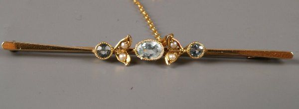 9ct gold three stone aquamarine and seed pearl bar