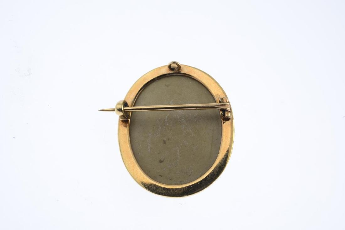 A mid Victorian gold lava cameo brooch. The oval lava - 2